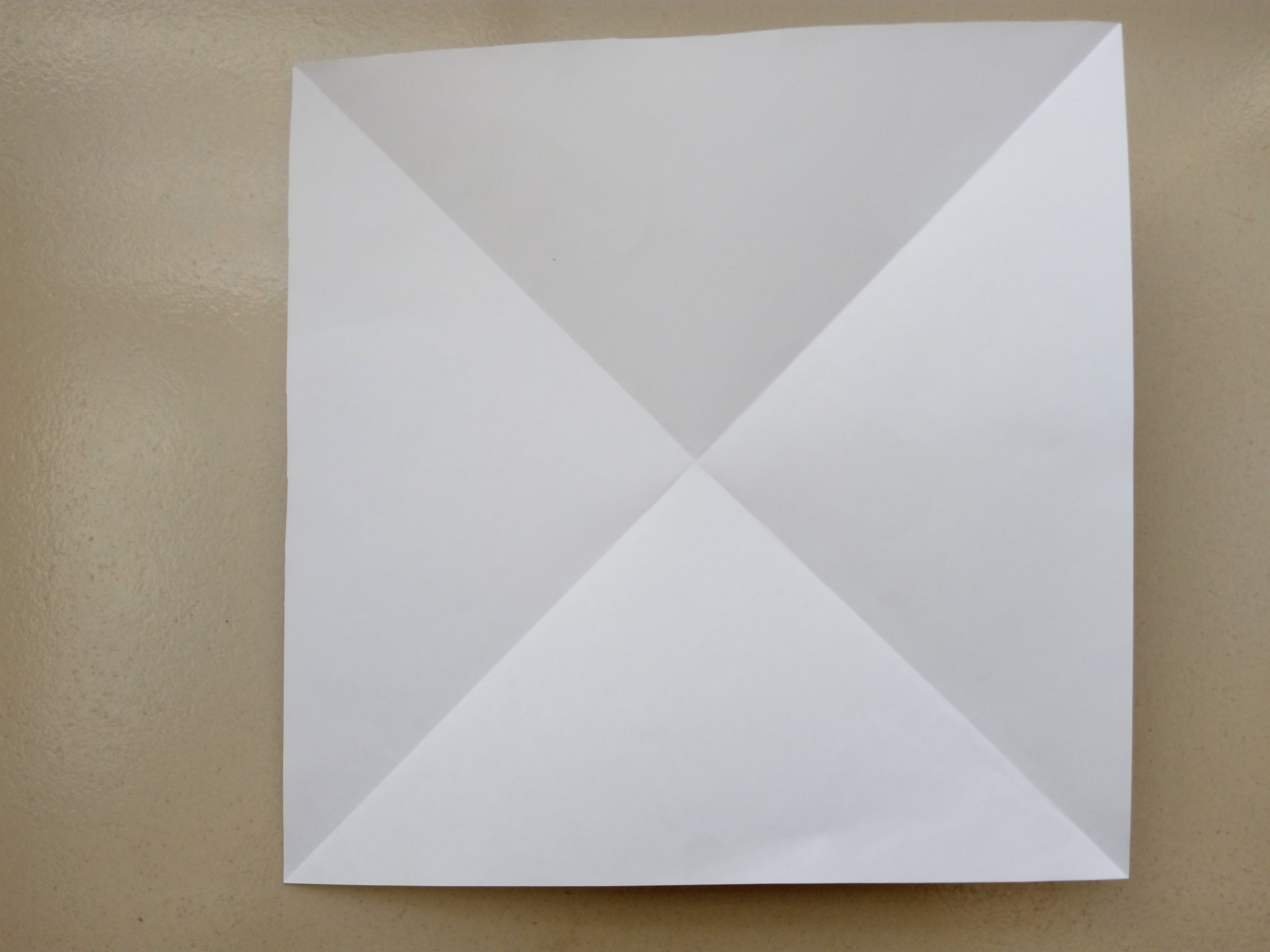 Picture of Fold the Square Paper in Half on Both Diagonal Axis. Cease Well and Unfold.