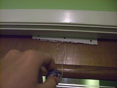 Slip Paper Over the Top of the Doorway