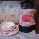 Reversible coffee pot warmer