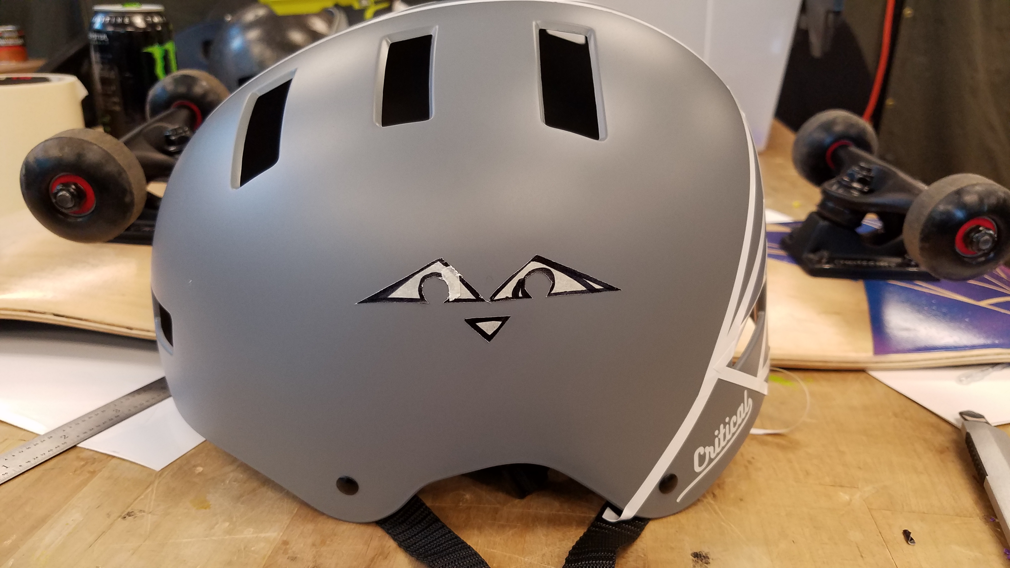 Picture of Make a Sloth Face Out of Masking Tape, and Transfer That to the Blank Side of the Helmet.