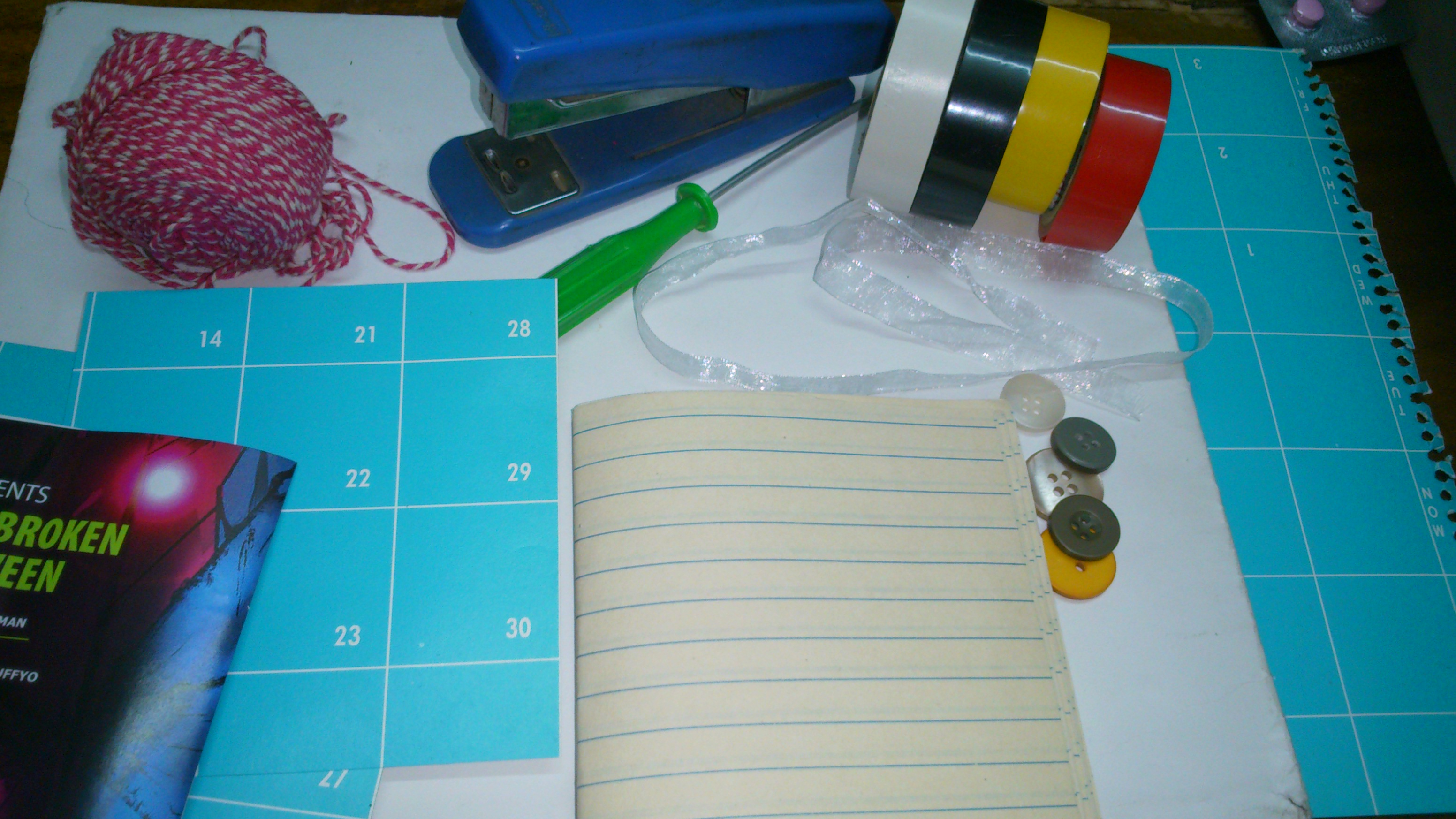 Picture of 1.Gather Your Materials- 1.Duct Tapes of Different Colours 2.Papers 3.sewing Thread 4.covering Papers You Like 5.scissor 6.buttons(optional)