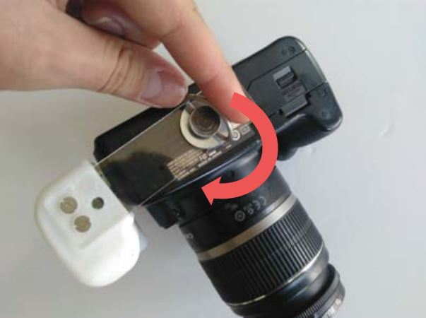 Picture of  Mounting the Handle Onto the Camera.