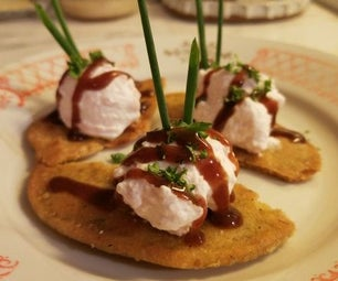 Goat Cheese and Spam Mousse on Millet Pita Chip With Black Cherry, Date and Balsamic Reduction Sauce.