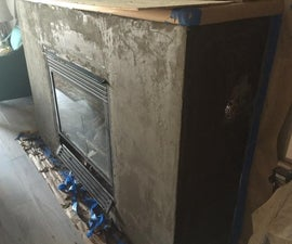 Smooth concrete look fireplace refinish.