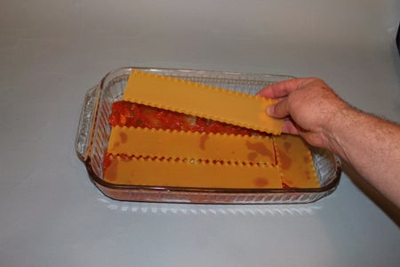 Lay Your First Layer of Lasagna Noodles