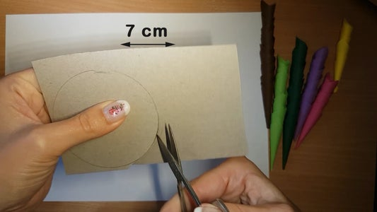 Cut a Circle of Cardboard and Grease the Edges With Glue