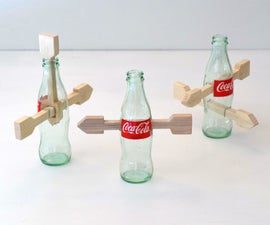 Arrow Through Coke Bottle - Four Variations