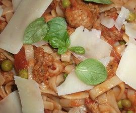 pasta with sausage, caramelised onion, petit pois, fennel seed and pecorino sardo