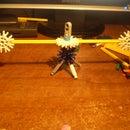 how to make a domino knocker just like in TeacherOfTheWays' s rube goldberg machine
