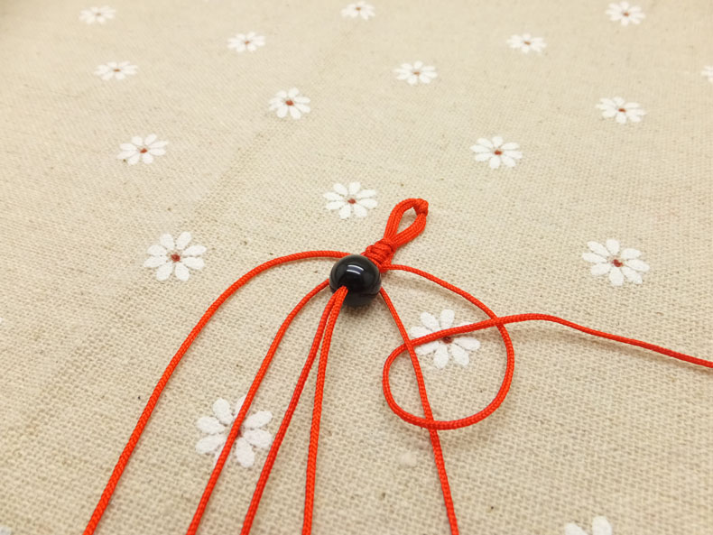 Picture of Starting With the Outer-right Cord, Tie a Backward Knot (as Shown) Make a Ninety Degree Angle With the Tying Cord Over the Top of the Cord You Are Tying It To.