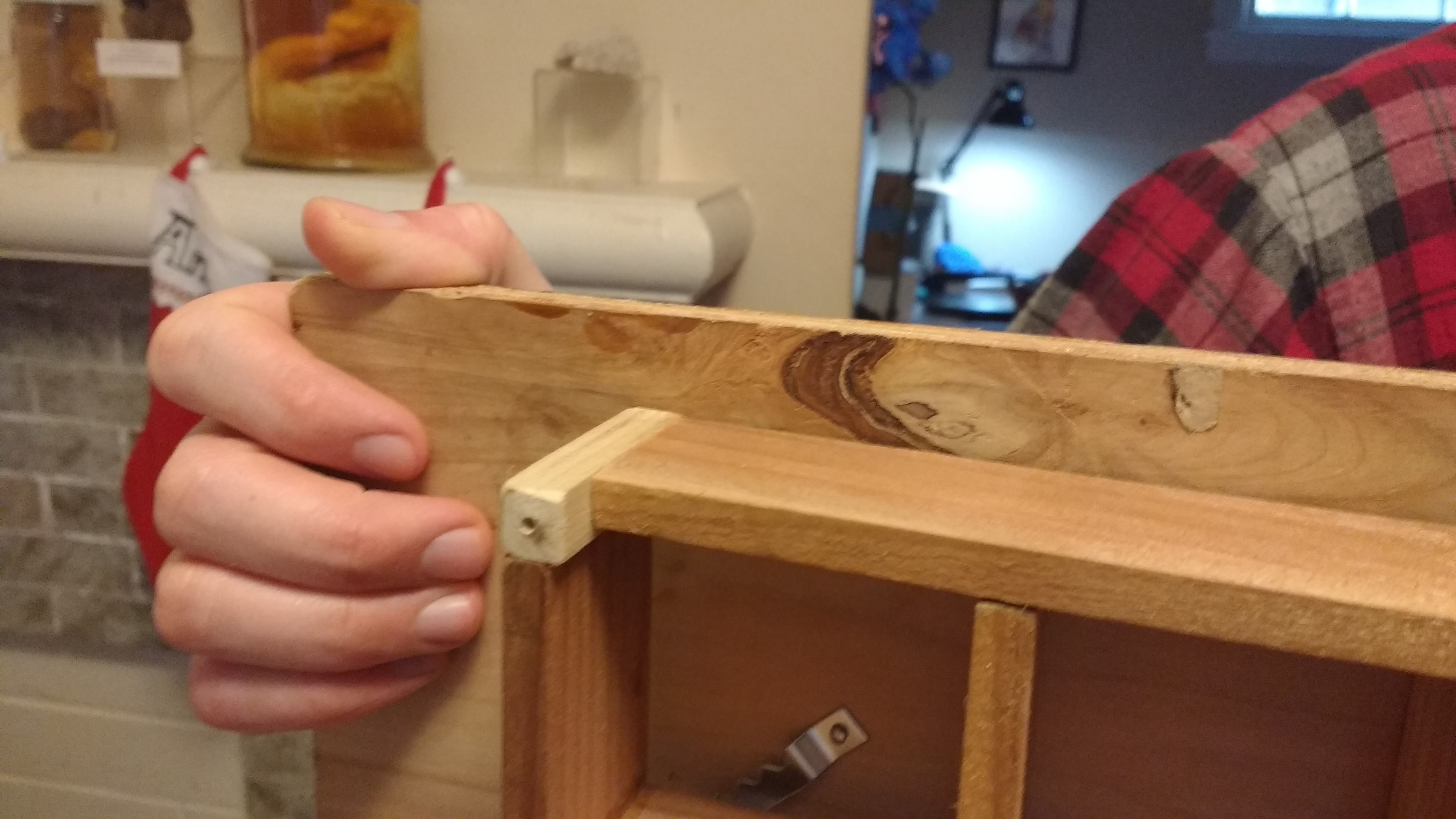 Picture of Drill the Holes to Mount the Shelf Assembly
