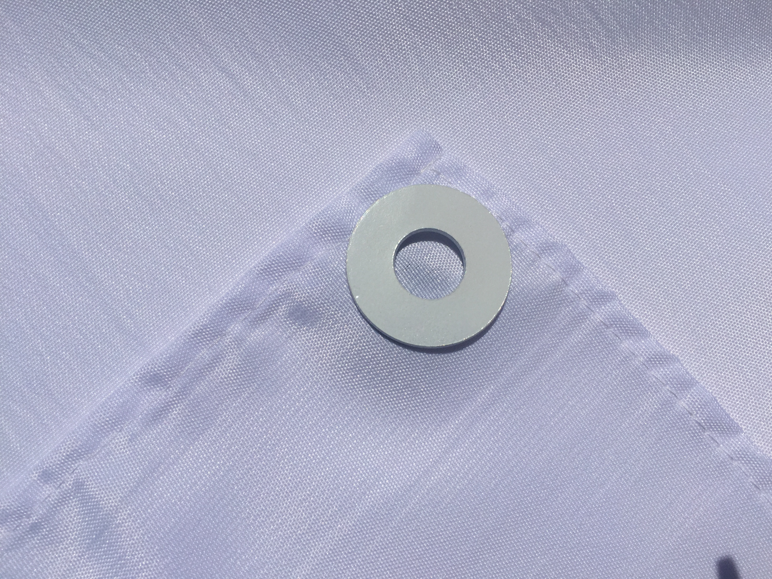 Picture of Attach Weights to Tablecloth