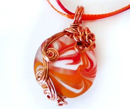 Wire Wrapped Swirls Glass Pendant