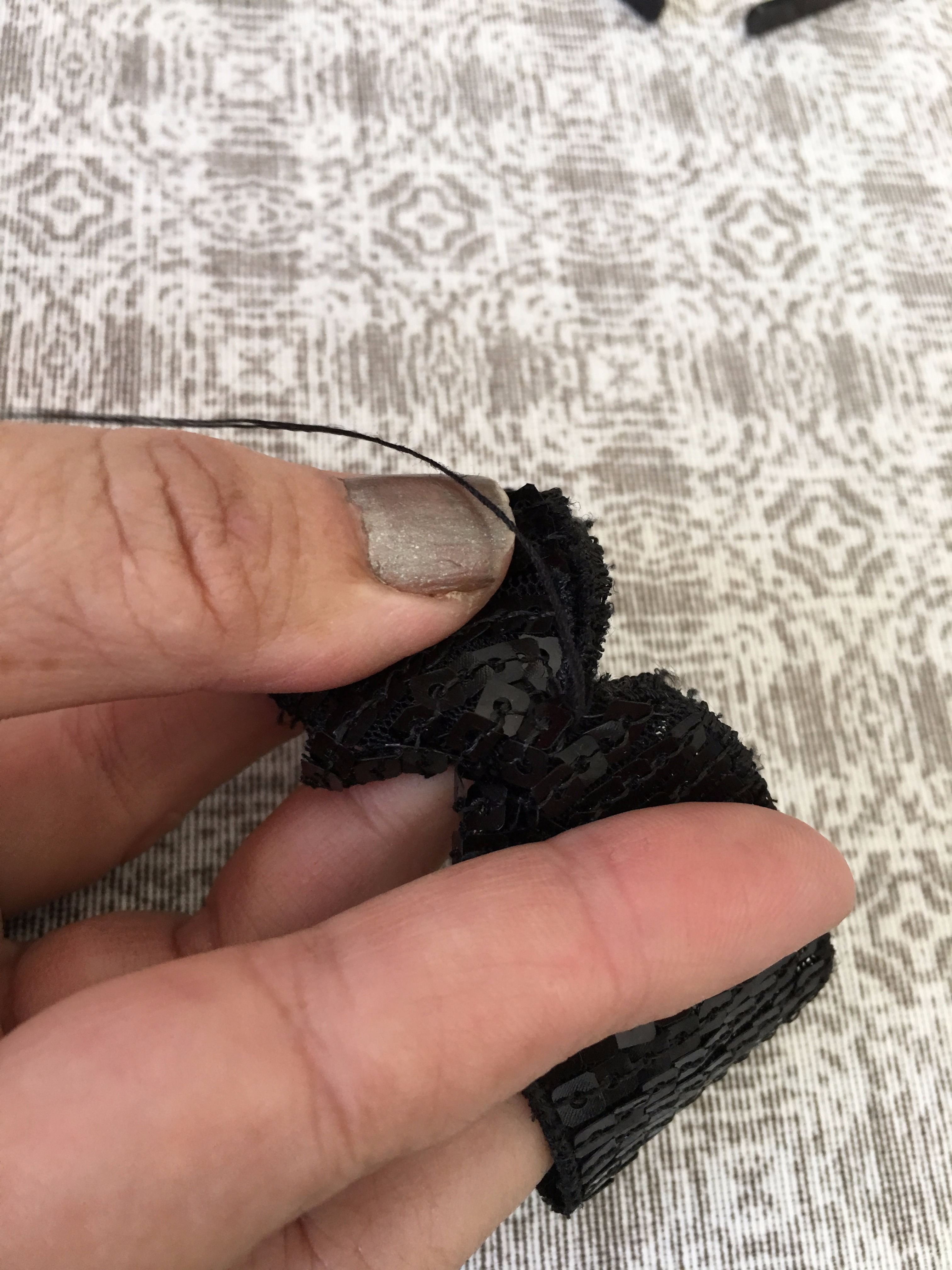 Picture of Tie With Thread and Needle