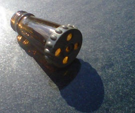 A kazoo from a glass bottle
