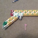 K'nex slingshot mech pistol/shotgun {PLOWS THROUGH PAPER}
