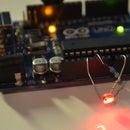 self calibrating laser trip wire