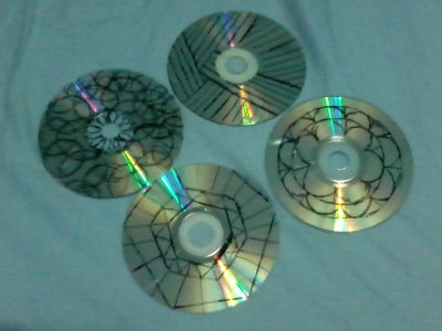 Draw on the CDs With the Marker.