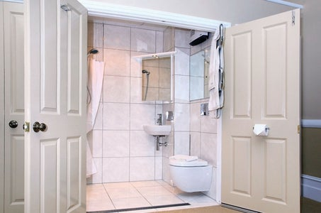 Disappearing Shower Curtain for Small Bathrooms
