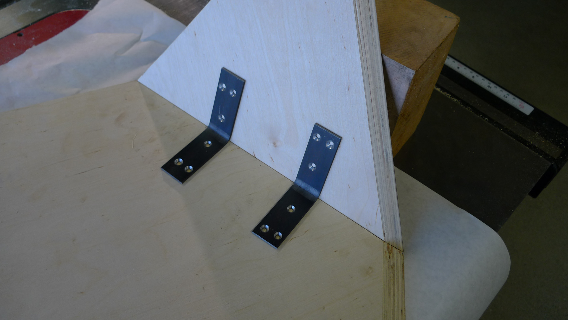 Picture of Pre-drill Holes, and Attach Brackets W/Wood Screws