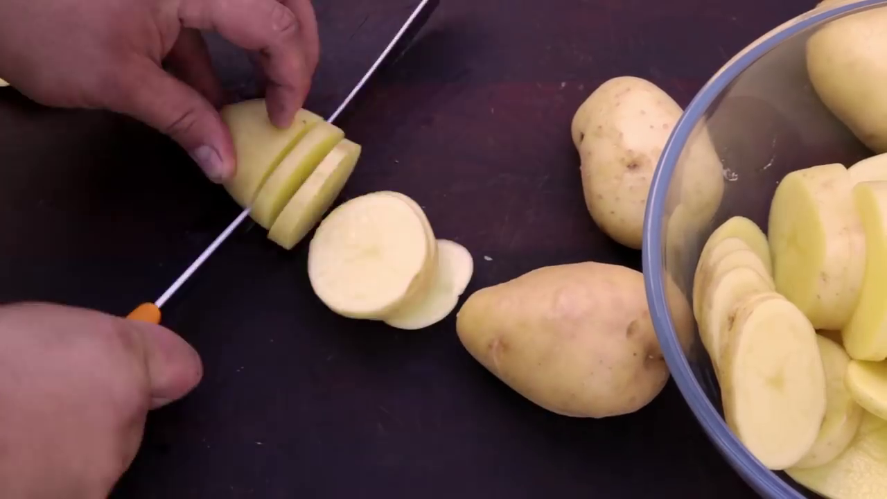 Picture of Cut the Potatoes Into Slice About a ¼ of an Inch Thick or Half a Cm.