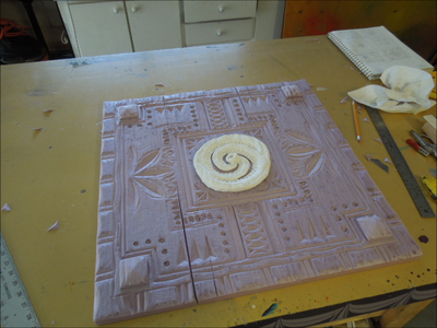 Apply a Clay Medallion in the Center