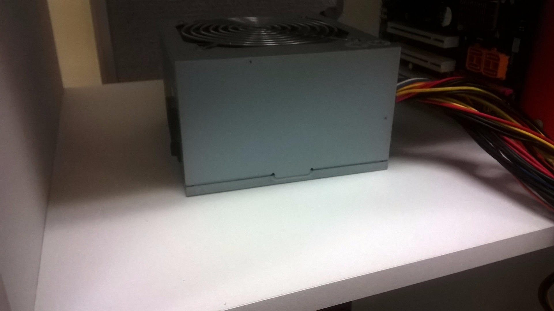 Picture of Mounting the Power Supply and Harddrive