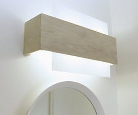 Camouflaging a Dated Off-center Bathroom Lighting Fixture