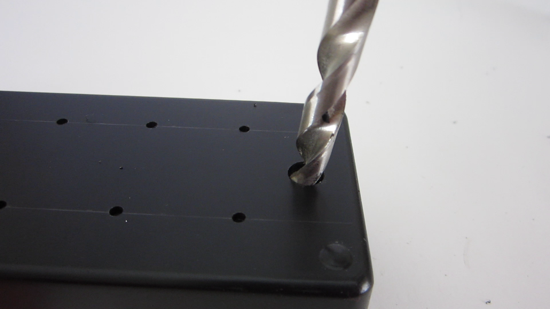 Picture of Drill Holes in the Top of the Housing for the Banana Jack Terminals and the Power Switc