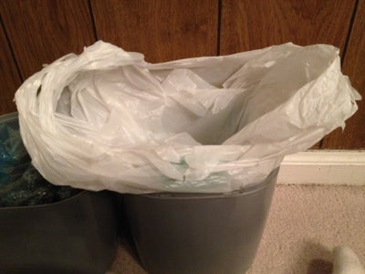 Line the Litter Genie Pail With an Ordinary Plastic Shopping Bag.
