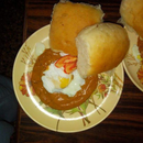 poached egg with Indian spicy tomato puree