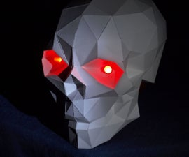 Papercraft skull with glowing eyes