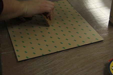 Apply Adhesive Tape to the Back of Your Newly Cut Plastic Sheet