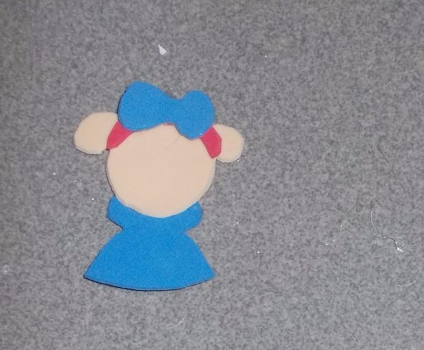 Picture of Glue the Headband Onto the Head and the Bow Onto the Headband.
