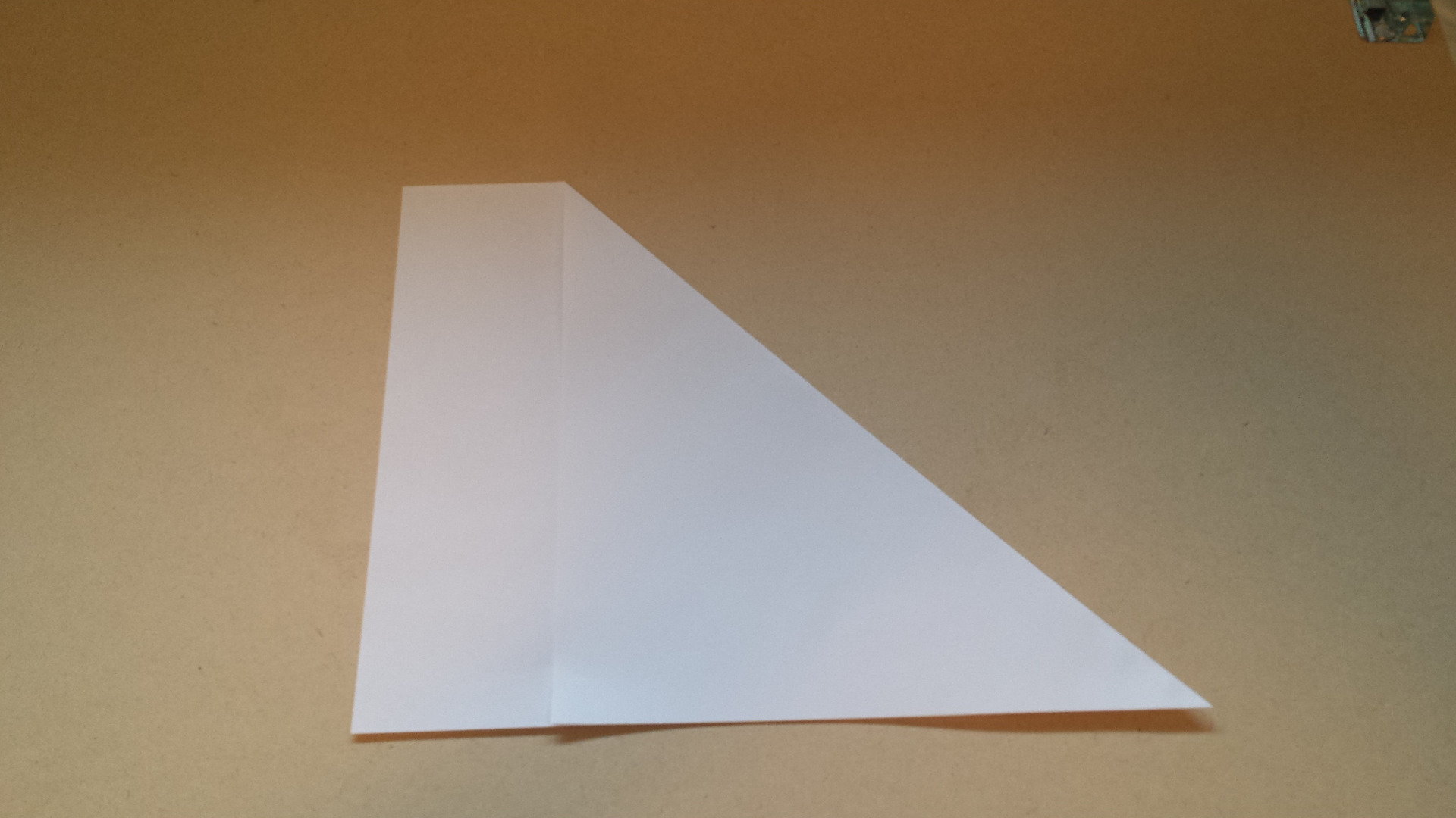 Picture of Fold Diagonally So That the Edges Line Up Together and Form a Right Triangle
