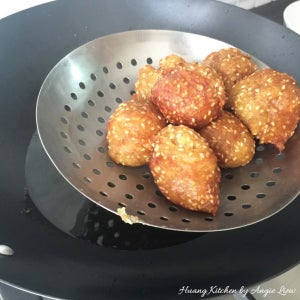 When It's Ready, Scoop the Fried Banana Balls Up Using a Strainer.