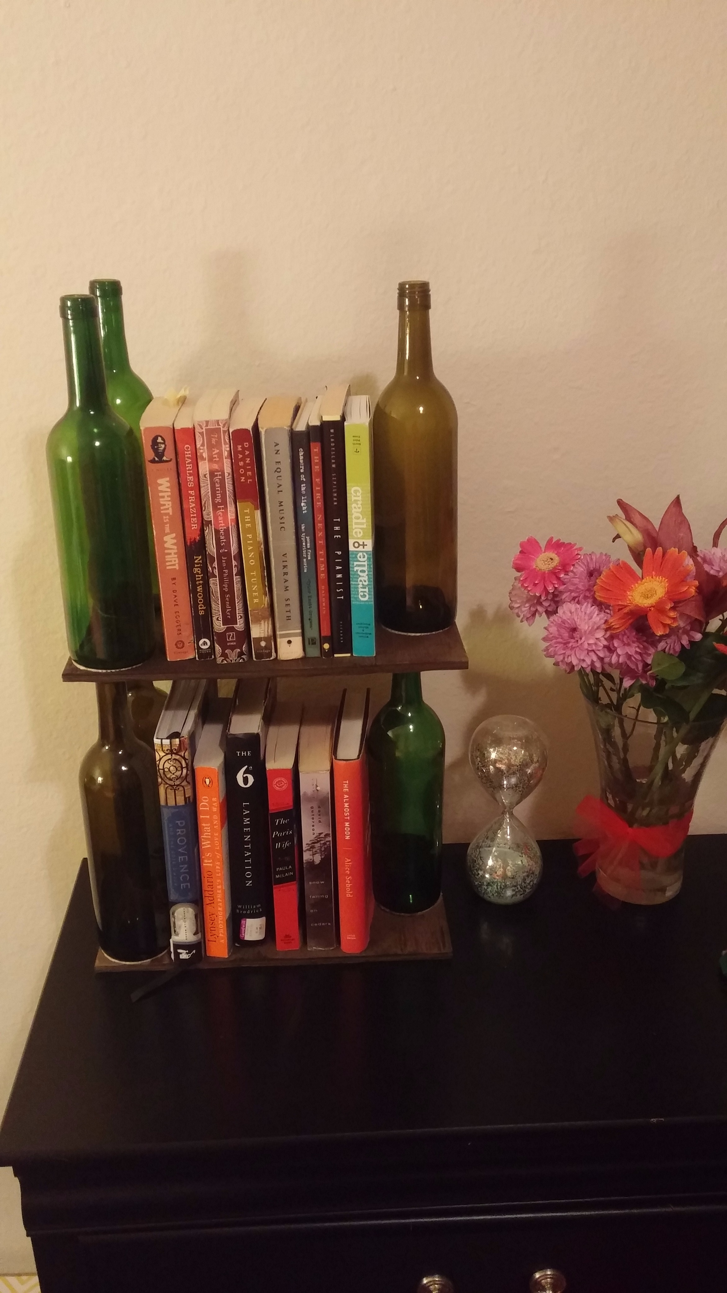 Picture of Add the Remaining Wine Bottles Directly Above the Others, on Top of the Board.