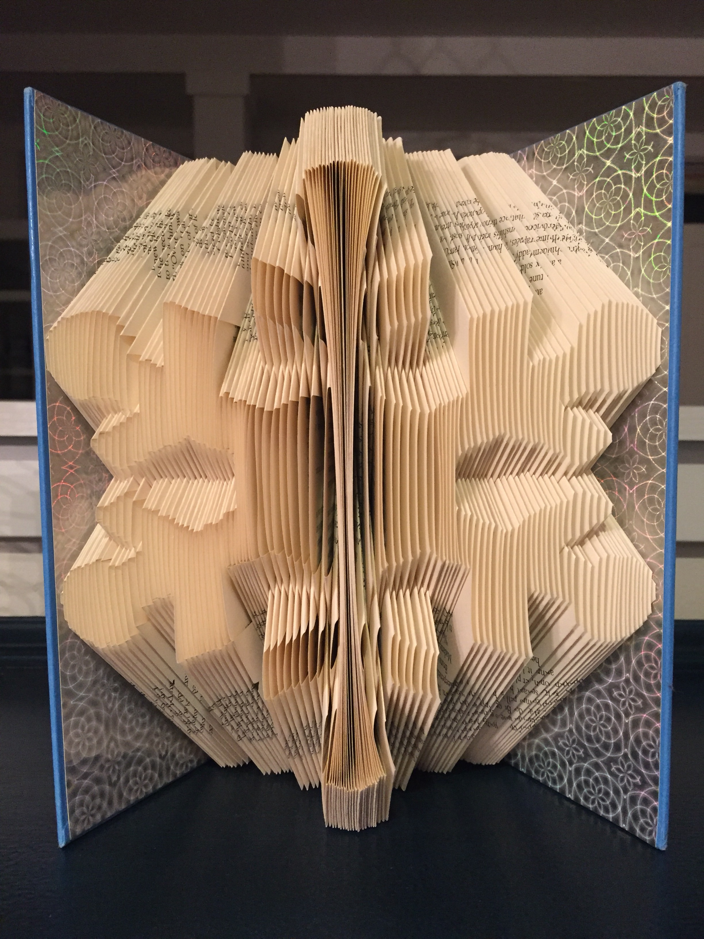 Picture of Snowflake Book Folding Pattern. Book Art Tutorial Using Template Pattern