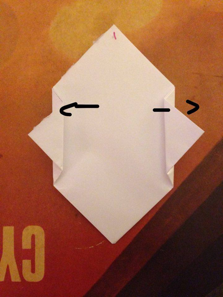 Picture of Fold the Two Tips of Your Paper Which Are Meeting in the Middle Outwards, This Will Create Your Frogs Feet!