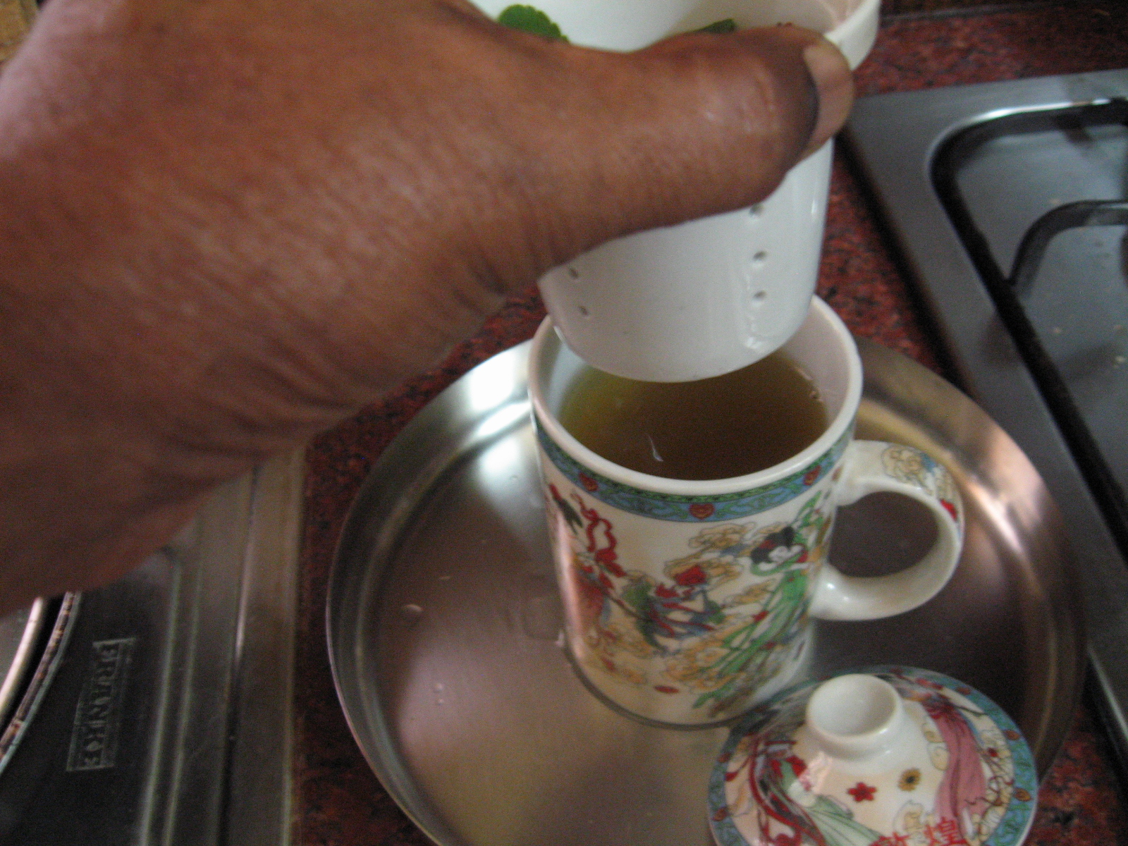 Picture of Pour Green Tea in Cups