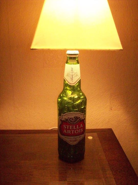 Picture of A Trio of Home Made Desk Lamps Made From Recycled Liquor Bottles..