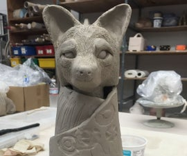 How to wrap a blanket to an animal head in clay