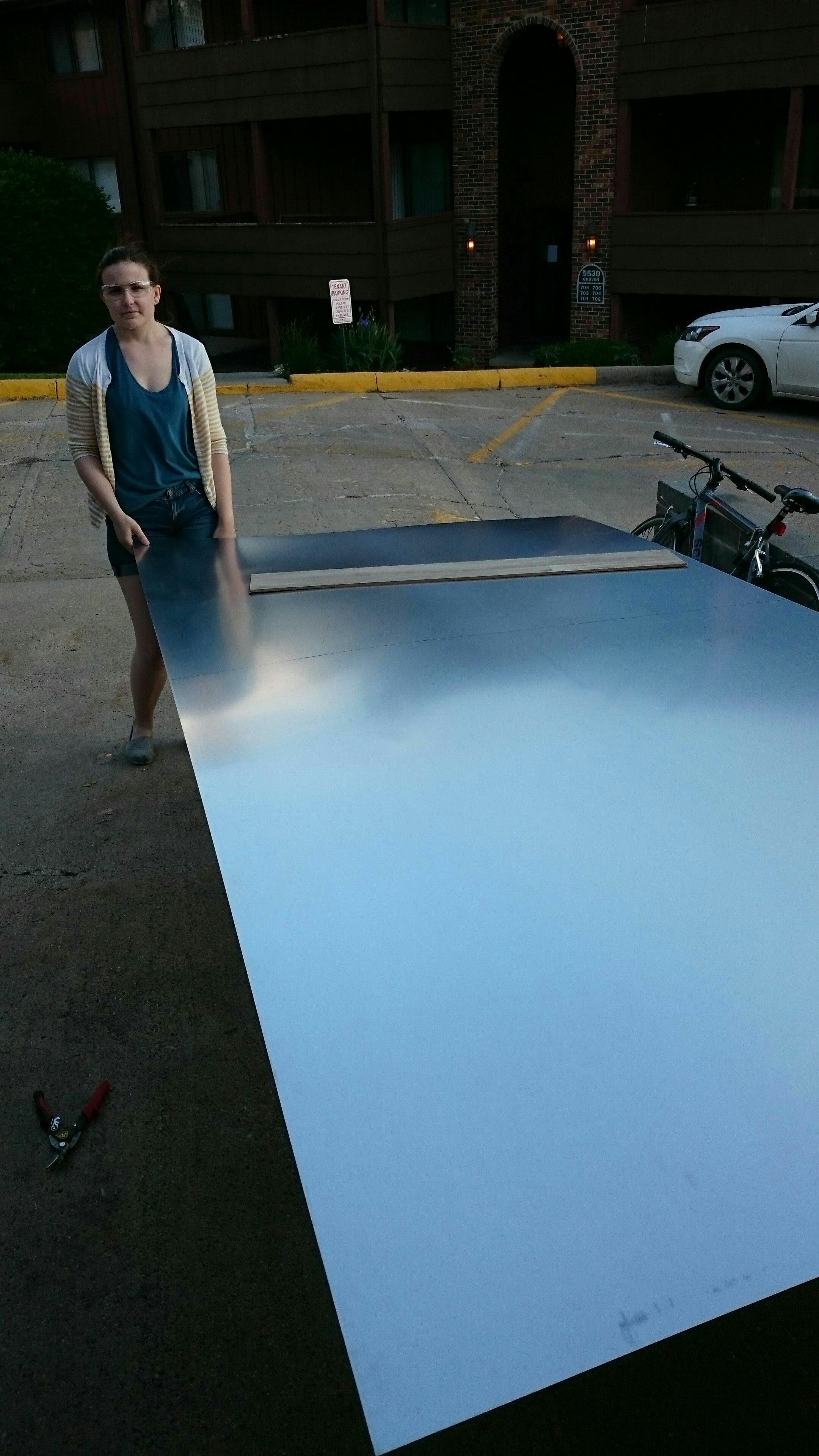 Picture of Putting on the Aluminum Sheeting!