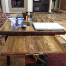 Resin top reclaimed wood coffee table with slide out TV tray and funky leg design