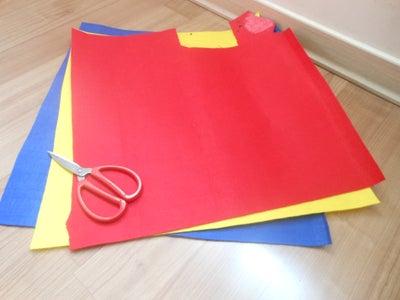 Use the Felt Fabric, Thread, Needle, Glue Gun and Scissors.