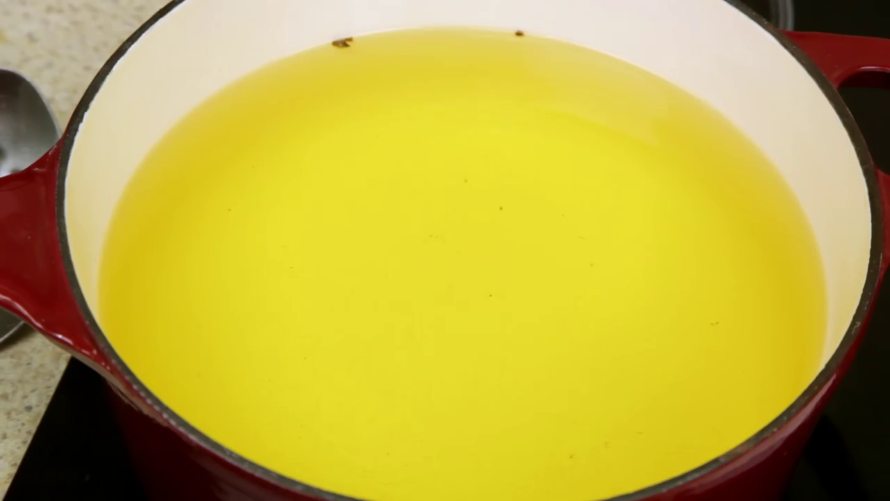 Picture of Fill a Cast Iron Pot ¾ Full With Canola Oil.