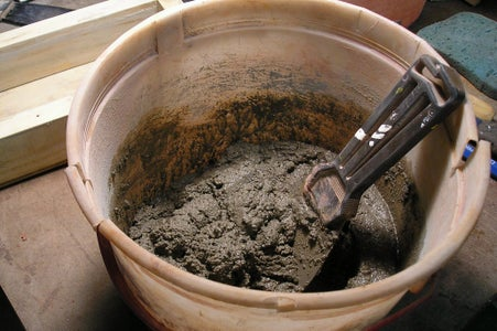 Mix Up a Batch of Concrete Mix With Colorant If Wanted