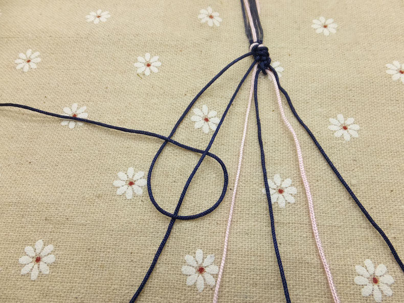 Picture of Then Loop It Under and Back Through the Opening. Don't Forget to Knot Twice Over Each Cord!