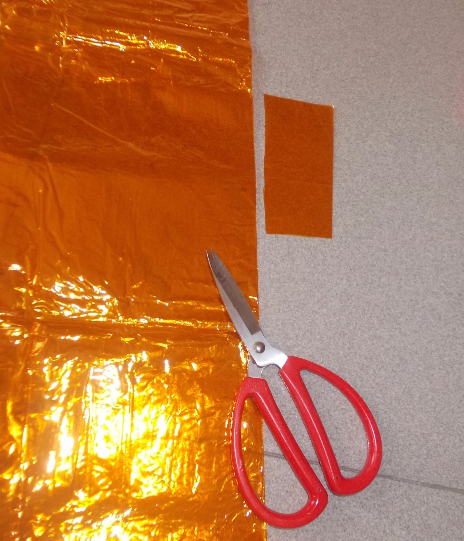 Picture of Use the Glass Paper. Cut a  Glass Paper Rectangle Which Is Larger Than the Hole.