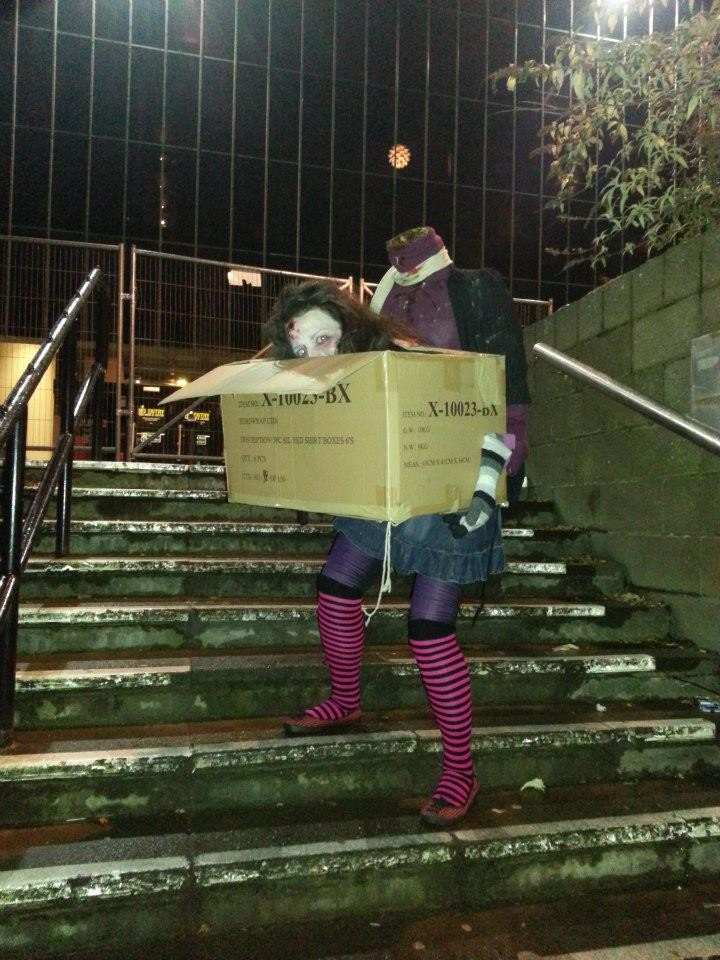 Picture of Headless Zomby Woman Carrying Her Own Head on a Box